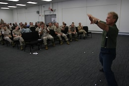 Steve Verret gives love to the crowd during the Stevie Springer Show. The show was a skit given to service members and civilians who attended a driving safety brief May 22 at the Marine Forces Pacific Headquarters Building, Camp H M Smith. Verret is a comedian and traffic safety specialist.