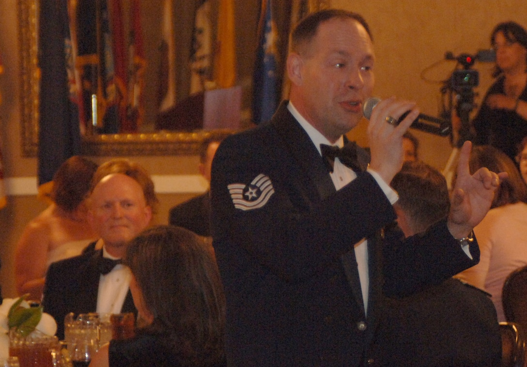 "Technical Sgt. James Dill, 14th Civil Engineer Squadron, entertains the guests of Senior Master Sgt. McCarty's recognition ceremony during dinner with his rendition of ""Walking to Memphis."" (U.S. Air Force photo by Airman Josh Harbin)"