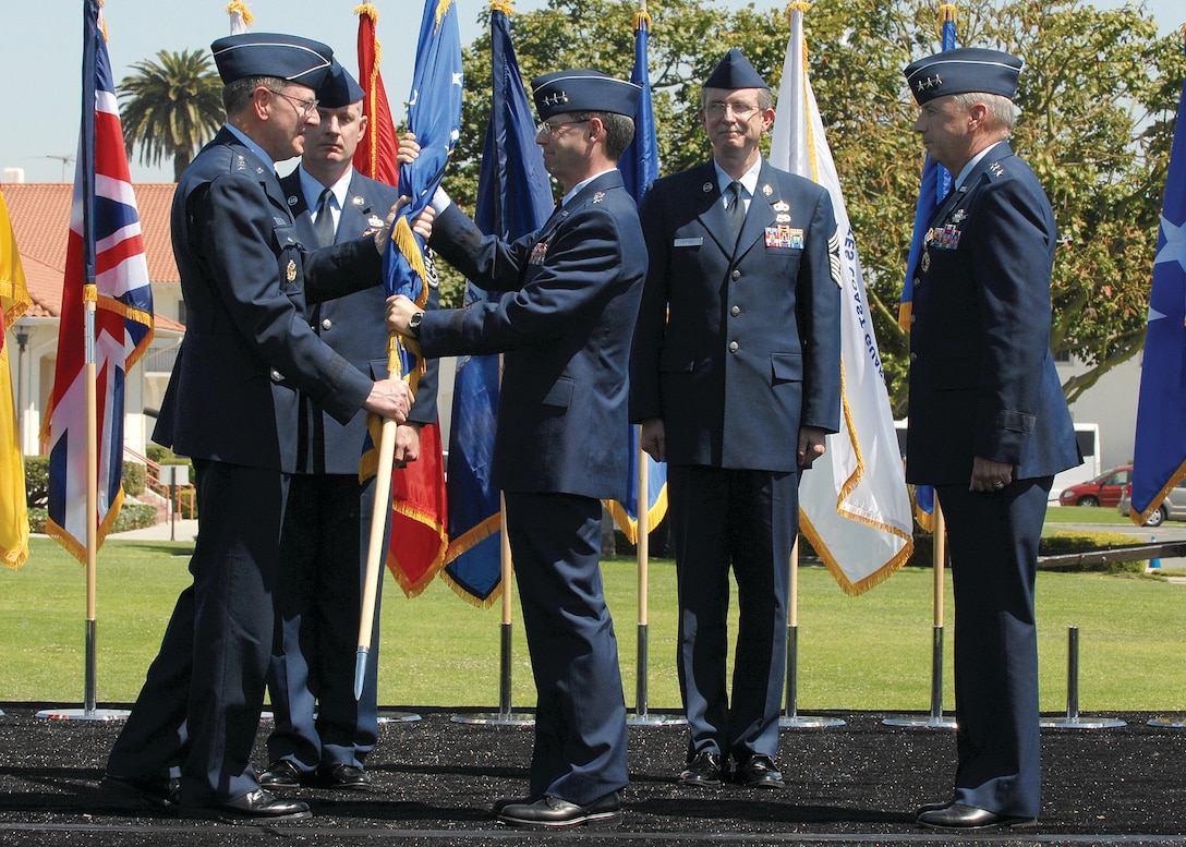 Lt. Gen. John T. 'Tom' Sheridan accepts the SMC guidon from AFSPC Commander, General Robert Kehler signifying his acceptance of command as the new commander of Air Force Space Command's Space and Missile Systems Center. Lt. Gen. Sheridan was formerly Deputy Director of the National Reconnaissance Office.