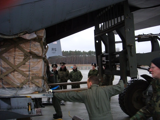 Members of the 86th Airlift Wing demonstrate C-130 uploading operations with visiting Russian Air Force delegation members in November of 2007 on Ramstein Air Base, Germany.