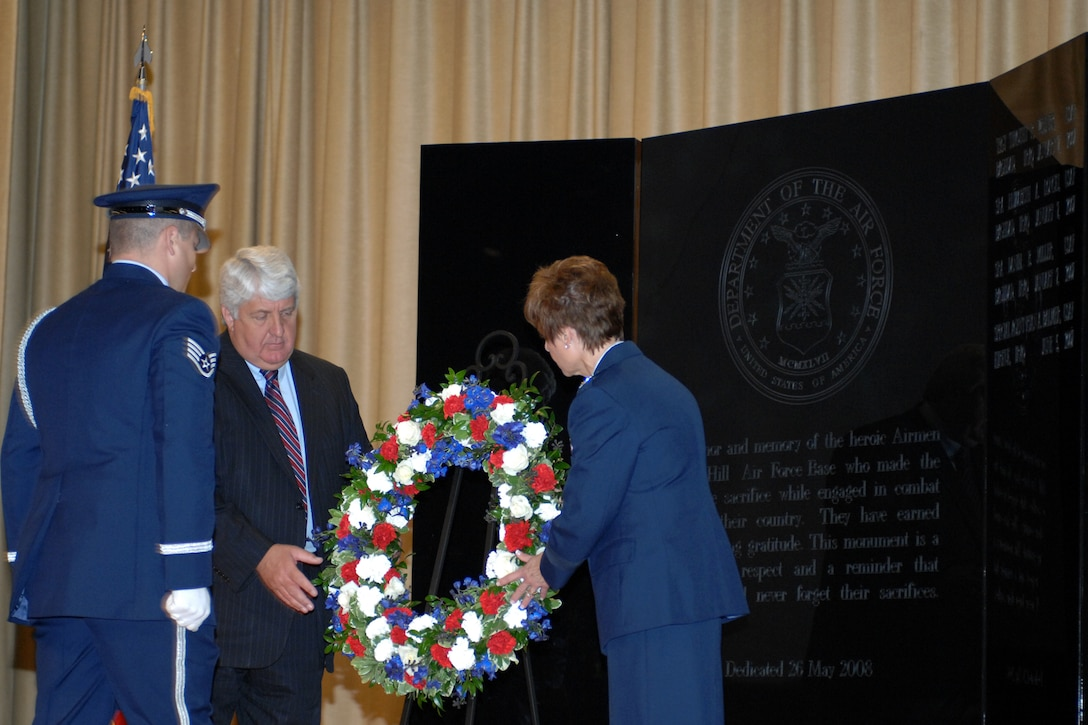 U.S. Rep. Rob Bishop (center) and Maj. Gen. Kathleen Close, Ogden Air Logistics Center commander, place a Memorial Day Wreath during a ceremony held to dedicate the new Hill Memorial Park for the fallen Airmen of Hill Air Force Base. (U.S. Air Force Photo by James Arrowood)