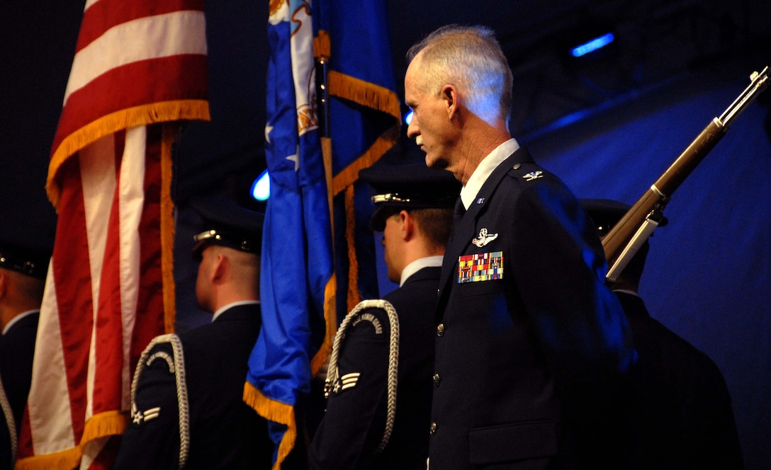 "Col. Robert S. Arthur, 442nd Fighter Wing commander, stands at attention while the Whiteman Air Force Base Honor Guard marches off-stage in front of the Kansas City Symphony during a  Memorial Day observance, May 25, 2008.  Colonel Arthur was the military master of ceremonies for the annual ""Celebration at the Station"" observance produced by the Kansas City Symphony at Union Station and the World War I Liberty Memorial in downtown Kansas City.  The evening's events included patriotic music performed by the symphony, as well as ceremonies honoring all members of the U.S. armed forces in front of more than 40,000 spectators.  The 442nd Fighter Wing is an Air Force Reserve A-10 Thunderbolt II-unit based at Whiteman Air Force Base, Mo. (U.S. Air Force photo/Maj. David Kurle)"