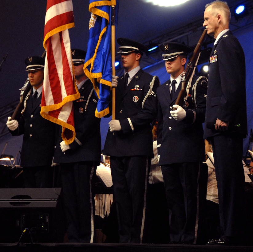 "Col. Robert S. Arthur, 442nd Fighter Wing commander, stands at attention with the Whiteman Air Force Base Honor Guard while the Kansas City Symphony plays the Air Force Song to observe Memorial Day, May 25, 2008.  The members of the honor guard are, left to right, Airman 1st Class Gregory Diaz, Airman 1st Class Jonathan Leonard, Senior Airman Andrew Hammes and Airman 1st Class Brian Lowes.  Colonel Arthur was the military master of ceremonies for the annual ""Celebration at the Station"" observance produced by the Kansas City Symphony at Union Station and the World War I Liberty Memorial in downtown Kansas City.  The evening's events included patriotic music performed by the symphony, as well as ceremonies honoring all members of the U.S. armed forces in front of more than 40,000 spectators.  The 442nd Fighter Wing is an Air Force Reserve A-10 Thunderbolt II-unit based at Whiteman. (U.S. Air Force photo/Maj. David Kurle)"
