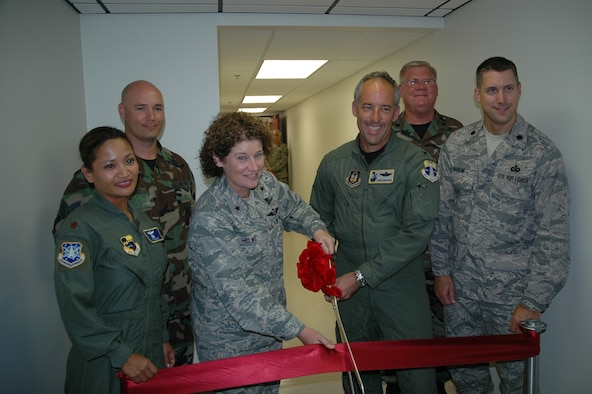 Left to right, Maj. Janice Hance, Tech. Sgt. Anthony Beasley, Brig. Gen. Susan Helms, Col. Steve Kirkpatrick, Lt. Col. Rex Meyer, and Lt. Col. Jerald Narum cut the ribbon commemorating the opening of the combined command post May 20 - the first of its kind in Air Force Space Command. (U.S. Air Force photo by Chris Calkins)