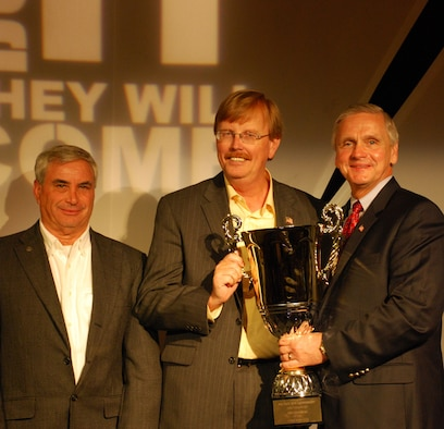 Patrick commissary store director Ron Rogers (center) receives the Director's Award for the best commissary in the superstore category at the Defense Commissary Agency's 2008 awards luncheon held Tuesday, May 20, at Richmond, Va. Handing the award is Mr. Rick Page, acting director of DeCA, and looking on is Max Kraftchick, DeCA's Florida Zone manager. Super commissaries are stateside stores with annual sales greater than $40 million. (Photo courtesy of Defense Commissary Agency)