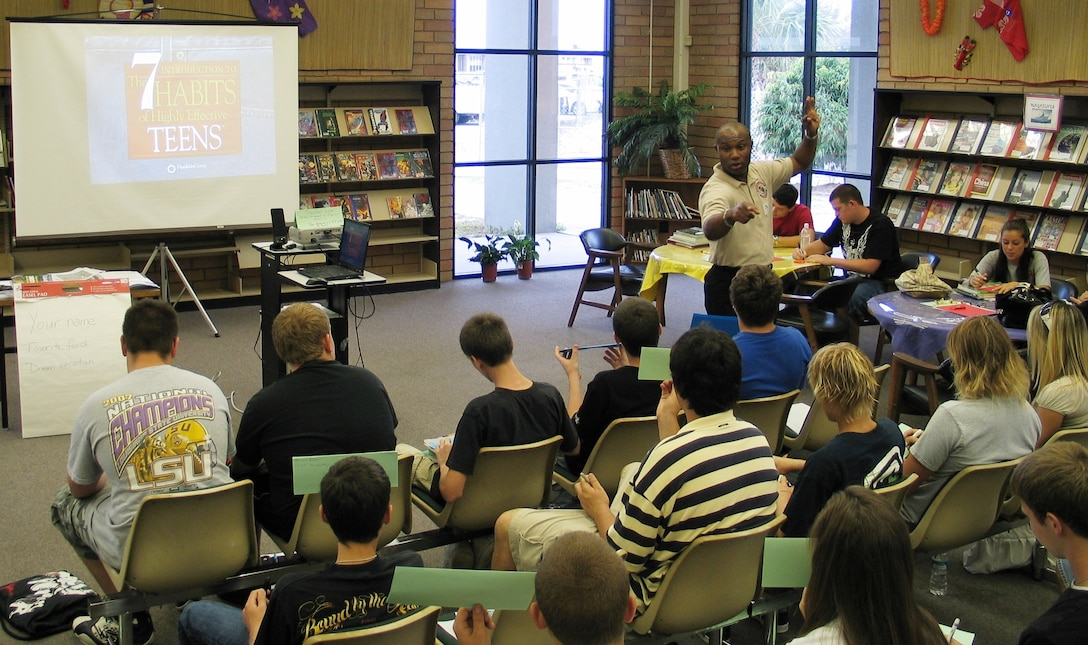 Master Sgt. Stephen Love from the Patrick Air Force Base Equal Opportunity Office (standing in tan shirt) speaks to students from Satellite High School May 19. (U.S. Air Force photo by Airman 1st Class David Dobrydney)