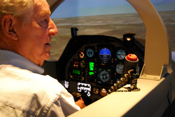 Retired Air Force Lt. Col. Bill Peel, a veteran of World War II and the Korean and Vietnam wars, works to get his bearings May 23 during a T-6A Texan II flight simulator ride at Sheppard Air Force Base. Mr. Peel was treated to a ride during his visit to the 80th Flying Training Wing, but his thoughts are with his fallen comrades killed during each war in which he served. (U.S. Air Force photo/John Ingle)