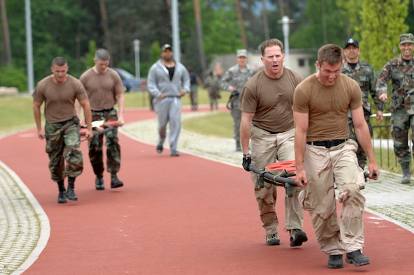 2nd Lt Tom Smith and Master Sgt. Jason Lydon, right, edge out Tech. Sgt Brian Bowen and Tech. Sgt. Eric Dibartolomeo, left, while carrying 190 lbs. on a gurney as part of the Total Fit challenge hosted by the Health and Wellness Center, Ramstein Air Base, Germany May 21, 2008. With the time of 10:41 2nd Lt. Smith and Sergeant Lydon took second place while beating out the competition by 4 seconds. (U.S. Air Force photo by U.S. Airman 1st Class Nathan Lipscomb) (RELEASED*)