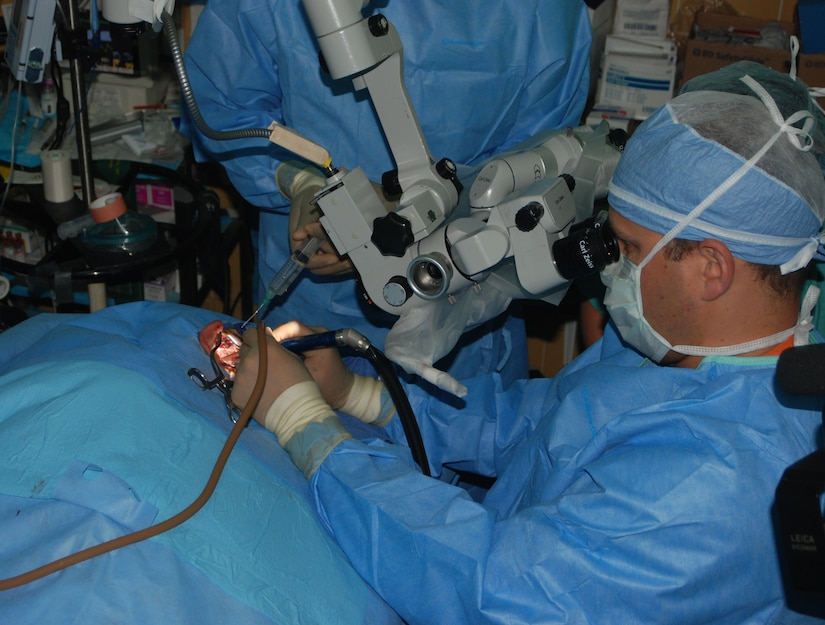 Maj. (Dr.) Scott Howard, an ear, nose and throat surgeon from Walter Reed Army Medical Center in Washington, D.C, performs ear surgery on a Honduran patient in San Pedro Sula, Honduras. A 13-person ENT team from Walter Reed performed screenings, hearing aid fittings and surgeries May 17-28 at Hospital Leonardo Martinez V. (U.S. Air Force photo/Tech. Sgt. John Asselin)