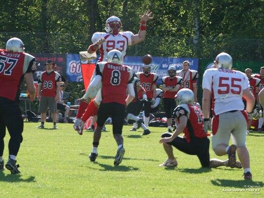 Senior Airman Jordan Gourley blocks a kick while playing for the Kaiserslautern Pikes, a German semi-pro American football team. Courtesy photo