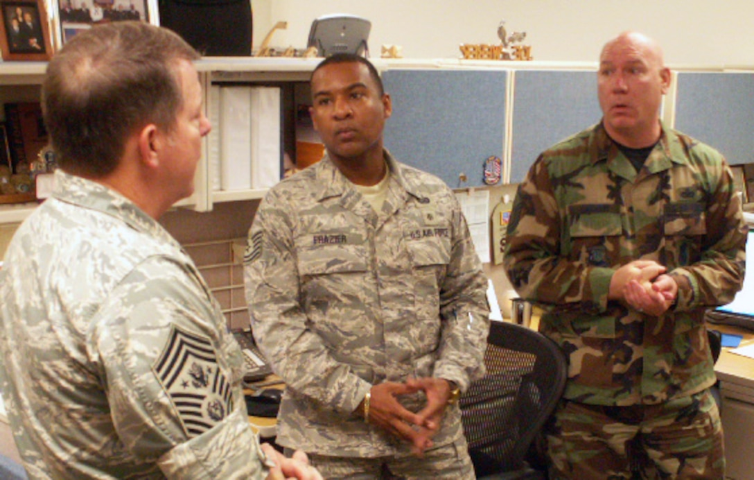 Tech. Sgt. Reginald D. Frazier and Master Sgt. John P. Draven brief Chief Master Sgt. of the Air Force Rodney J. McKinely May 29 on AEF 7-day ops during his visit to the Air Force Personnel Center here at Randolph Air Force Base, Texas. (US Air Force photo/Master Sgt. Kat Bailey)