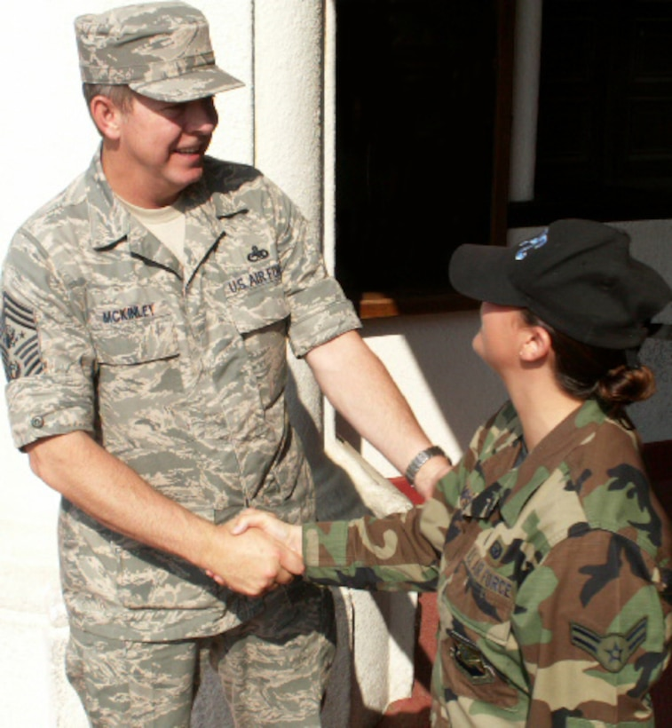Airman 1st Class Lillian Thompsett, a personnelist at the Air Force Personnel Center here, greets Chief Master Sgt. of the Air Force Rodney J. McKinley outside the Randolph Air Force Base theater. The chief attended AFPC's commander's call and spent the day visiting with Airmen and civilians from AFPC. (US Air Force photo/Master Sgt. Kat Bailey)