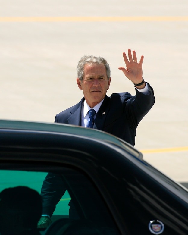 President George W. Bush walks to his limousine waving before heading to a fund raising campaign meeting in Salt Lake City, Utah. Utah Air National Guard Base, Salt Lake City, Utah May 28, 2008.