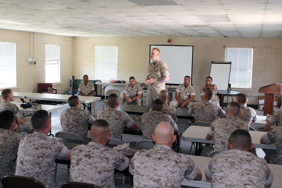 Sgt. Jack Durgala, a Marine with Wounded Warrior Battalion-East, Wounded Warrior Regiment, Manpower and Reserve Affairs, speaks to Marines from Student Administrative Company, School of Infantry, about his injuries here May 29. Durgala and five other wounded warriors spoke to the Marines about staying motivated after an injury.