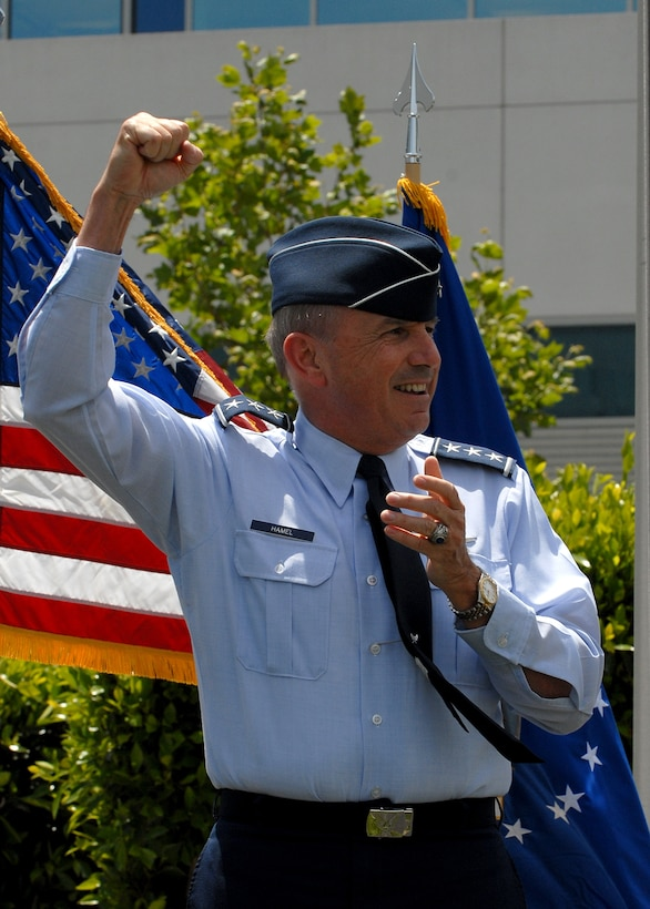 Lt. Gen. Michael Hamel leads the crowd in singing the Air Force song. The general bid farewell to the SMC workforce, May 15. (Photo by Joe Juarez)