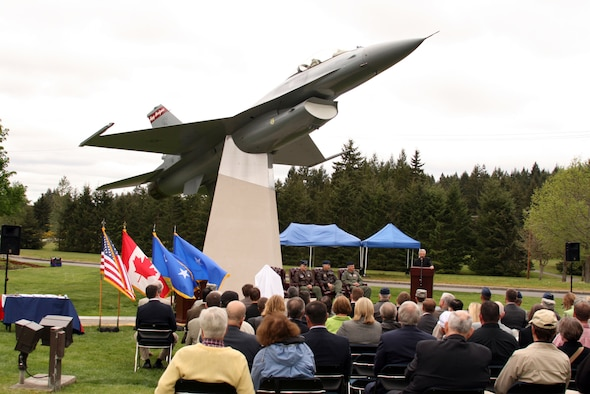 The F-16 fighter's place in air defense history is assured with this permanent display of aircraft #82-929, which was scrambled over the eastern coast on Sept. 11, 2001. The pilot on that eventful day, Lt. Col. Brad Derrig, attended the dedication ceremony at the Western Air Defense Sector on May 21 and talked about the shock and drama of combat air patrols on that date. (U.S. Air Force photo/Randy Rubattino)
