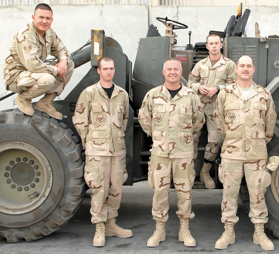 442nd Logistics Readiness Squadron vehicle operators, Senior Airman Matt Brown, Staff Sgt. Josh Burr, Staff Sgt. Craig Alexander, Senior Airman Robert Long and Tech. Sgt. Rick Laney, pause for a group photo to commorate their deployment to Iraq. The five transporters helped  meet Kirkuk Air Base's varied transportation requirements while deployed to Iraq for six months.  The five Citizen Airmen are members of the 442nd Logistics Readiness Squadron, part of the Air Force Reserve's 442nd Fighter Wing, based at Whiteman Air Force Base, Mo.  (Courtesy Photo)