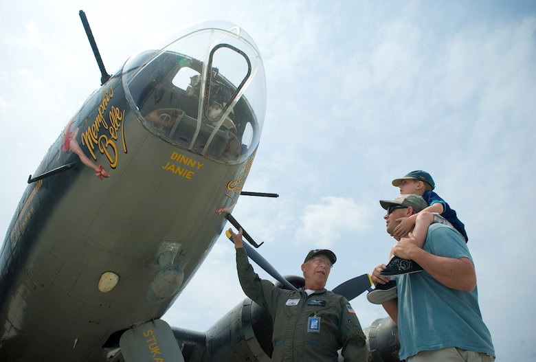 "Korean War-era veteran Bob Selden shares the history of the B-17 Flying Fortress with Jason Morris and his son, Brody, during the 2008 McGuire Air Expo May 31 at McGuire Air Force Base, N.J. Base officials hosted the air expo, which concluded Air Force Week in Philadelphia. Mr. Selden is a volunteer crew member of the ""Memphis Belle."" (U.S. Air Force photo/Staff Sgt. Bennie J. Davis III)"