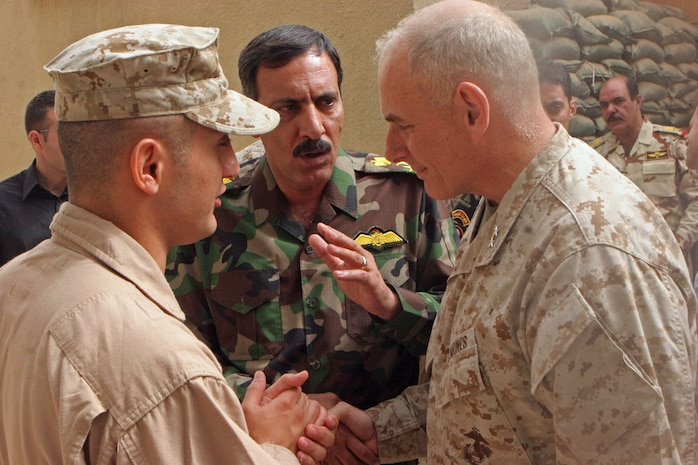 Maj. Gen. John F. Kelly, commanding general, Multi National Forces-West, speaks to Iraqi Brig. Gen. Nour al Din, the chief intelligence official in Al Anbar after a meeting aboard Camp Habbaniyah May 31. Maj. Gen. Kelly facilitated the meeting between high ranking officials in the Iraqi Army and Iraqi Police and members of the Brookings Institution and Harvard University.