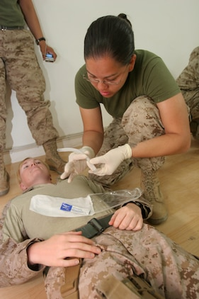 (May 31, 2008) ? Cpl. Gizelle Gutierrrez, an embark clerk with Marine Aircraft Group 16, 3rd Marine Aircraft Wing (Forward), prepares to insert a nasopharyngeal airway during a Combat Lifesaving class. The Lioness Program?s training regimen includes all-around skill training to prepare the Marines for a variety of emergency situations. (U.S. Marine Corps Photo by: Cpl. Jessica Aranda) 080531-M-8776A-001
