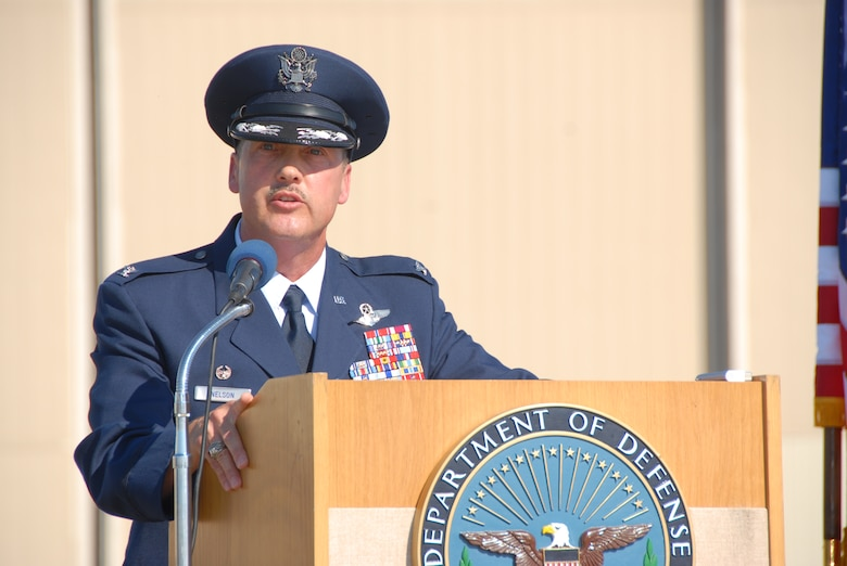 Col. Greg Nelson addresses members of the 123rd Airlift Wing after taking command of the unit Oct. 5. He began his career as an enlisted Airman and has served for more than three decades. (Photo by Tech. Sgt. Dennis Flora, Kentucky Air National Guard.)