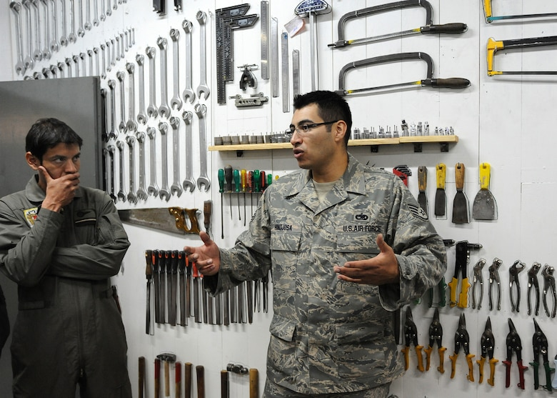 Air Force Staff Sgt. David Hinojosa (right) commends aircraft maintenance mechanics for the proper storage and organization of their units tools during a unit walk-through at Palomar Air Base, Buenos Aires, Argentina on Oct. 30. Sergeant Hinojosa, an aircraft structural maintenance instructor for the Inter-American Air Force Academy at Lackland Air Force Base, Texas. is participating in Operation Southern Partner -- an in-depth, two-week subject matter exchange emphasizing partnership, cooperation and sharing of information with partner nation Air Forces in Latin America. (Air Force photo/Staff Sgt. Bennie J. Davis III)