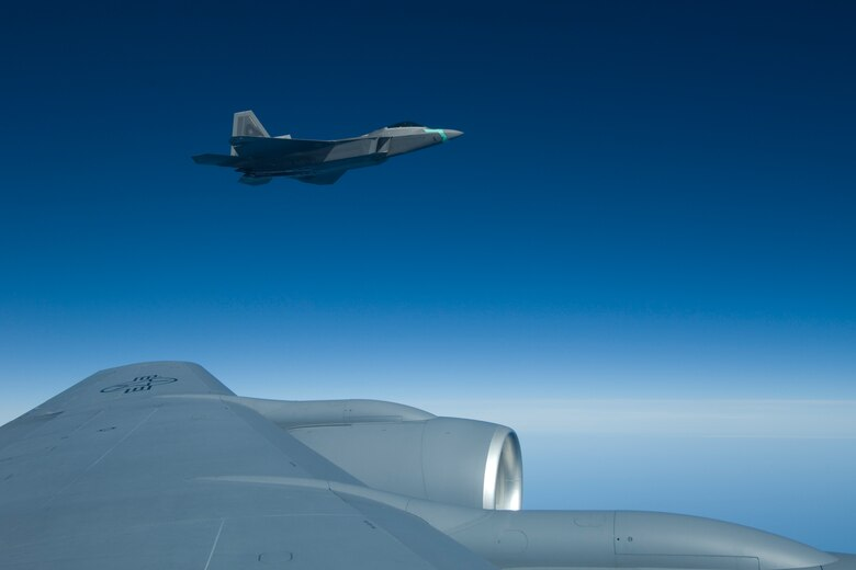 """An active duty F-22 Raptor from the 1st Fighter Wing from Langley AFB, Va. takes the wing of a 127th Wing KC-135 Stratotanker from Selfridge ANGB, Mich., during a """"Spouse Lift"""" refueling mission, where spouses of 127 Air Refueling Group members' spouses had a chance to observe the group's new mission first hand on Nov. 1, 2008.  (U.S. Air Force photo by Senior Airman Jeremy L. Brownfield) (Released)"""