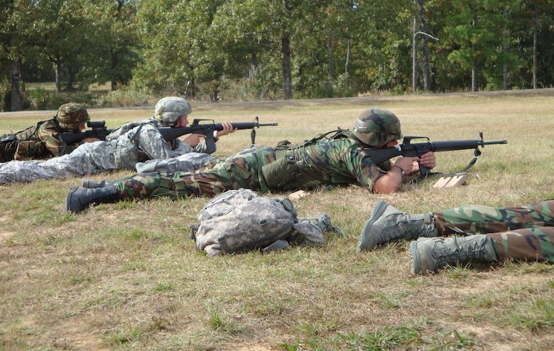 Master Sgt. Rocky Shaffer (center), 151st Logistics Readiness Squadron, fires the standard issue M-16 during a rifle match in the Winston P. Wilson National Shooting match in Little Rock, Ark. on October 13.  Sergeant Shaffer was part of 18 Utah Army and Air National Guardsmen that competed in the three day match.      U.S. Air Force photo