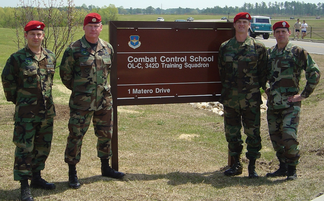 From left, Senior Master Sgt. Tom Deschane, Chief Master Sgt. Jon Rosa, Master Sgt. Wes Brooks and Capt. Sean McClane stand at Pope Air Force Base's Matero Drive. (Photo courtesy of Chief Master Sgt. Jon Rosa, Kentucky Air National Guard)
