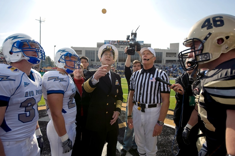 Navy Adm. Michael G. Mullen flips a coin at the beginning of the U.S. Military Academy and U.S. Air Force Academy football game Nov. 1 at West Point, N.Y. The Falcons defeated the Black Knights 16-7 in the annual battle. Admiral Mullen is the chairman of the Joint Chiefs of Staff. (Defense Department photo/Navy Petty Officer 1st Class Chad J. McNeeley)