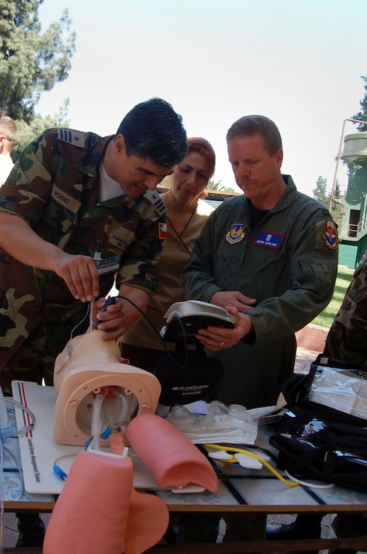 Lt. Col. Alger Rodo, the medical exchange coordinator for the Chilean Air Force, intubates, or inserts a tube into, the throat of a practice patient as U.S. Air Force Capt. Mark Gosling, from Brookes City-Base, San Antonio, instructs. Captain Gossling is part of about 70 Airmen participating in Operation Southern Partner, a Twelfth Air Force (Air Forces Southern) led event aimed at providing intensive, periodic subject-matter exchanges in the U.S. Southern Command area of focus, started Oct. 26. (Air Force photo/Master Sgt. Eric M. Grill)