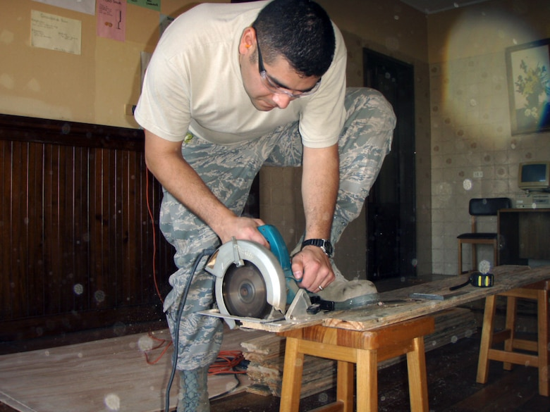Staff Sgt. Lorenzo Lara, one of two Rapid Engineer Deployable Heavy Operational Repair Squadron Engineer, or RED HORSE Airmen cuts wooden slats that were used to complete renovations of a dilapidated library at a Chilean culinary and hotel service high school in Quilpae, Chile Oct. 31 giving 80 students a comfortable and usable library the students and faculty can use for years to come. The renovation, the result of Operation Southern Partner -- a two-week Twelfth Air Force (Air Forces Southern) led event aimed at providing intensive, periodic subject matter exchanges with partner nations in the U.S. Southern Command area of focus -- took the two RED HORSE Airmen, and their Chilean civilian counterparts four days to complete; three days ahead of schedule. (Air Force photo/Master Sgt. Roger Wilhelm)