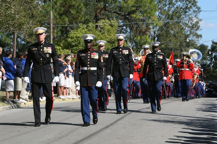 Gen. James T. Conway, 34th Commandant of the Marine Corps, along with Sgt. Major Carlton W. Kent, 16th Sergeant Major of the Marine Corps, lead Marines from Marine Barracks Washington during Gen. Robert H. Barrow's funeral in St. Francisville, La., Nov. 3.  Barrow, the 27th CMC, a veteran of three wars, with more than 40 years of service, passed away Oct. 30.