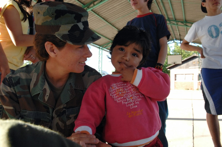 Staff Sgt. Mary Johanson holds a Chilean girl Oct. 30 at a home for abused or neglected children near Santiago, Chile. Sergeant Johanson is a 4th Combat Camera Squadron videographer from March Air Reserve Base, Calif. (U.S. Air Force photo/Tech. Sgt. Roy Santana)
