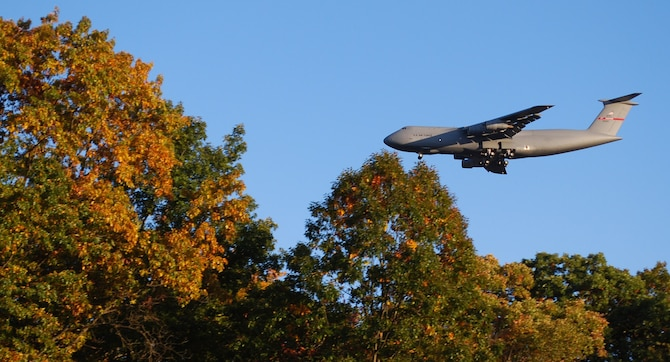The trademark foliage of New England appears to surround a Patriot Wing C-5 preparing to land at Westover. The mission of the 439th Airlift Wing is worldwide strategic airlift. The C-5 is the largest aircraft in the Air Force. (US Air Force photo/Tech. Sgt. Andrew Biscoe)