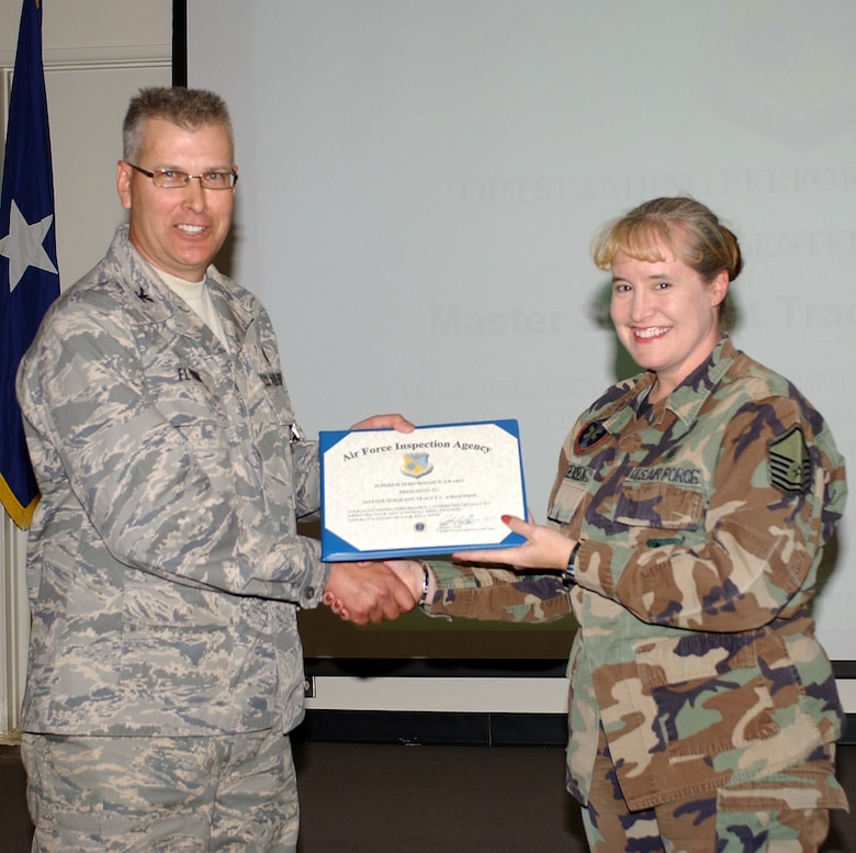 Team chief Col. John Flynn congratulates Master Sgt. Tracey Jorgensen for being an outstanding performer during the Health Services Inspection, Nov. 2. The wing's medical group scored a 98 percent—the highest of 50 Air Reserve Component (ARC) HSI's conducted this year by the Air Force Inspection Agency team. (Air National Guard photo by Senior Airman Sarah Elliott)