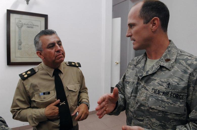 Maj. Phillip Mason talks with a Uruguayan army doctor Nov. 3 in Uruguay. Major Mason is from Wright-Patterson Air Force Base, Ohio. (U.S. Air Force photo/Tech. Sgt. Roy Santana)