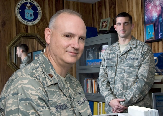 2nd Lt Aaron Reynolds, right, is doing an internship in the 167th Chapel Section, following in the footsteps of his father, Major David Reynolds, 167th Airlift Wing Chaplain. Reynolds was a member of the 167th Airlift Wing, but has transferred to the Air Reserves to participate in the chaplain candidate program. (U.S. Air Force photo by MSgt Emily Beightol-Deyerle)