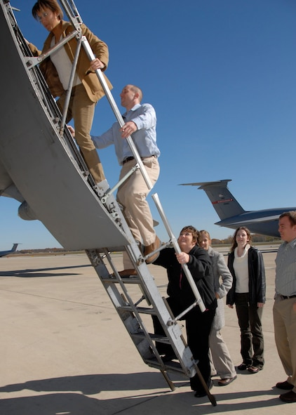 West Virginia medical students board a C-5 aircraft at the 167th Airlift Wing, West Virginia Air National Guard on Thursday October 31, 2008. The students, along with local doctors were invited to spend an afternoon at the Martinsburg, West Virginia unit which is looking for candidates to fill five flight surgeon vacancies at the unit. The medical students and professionals learned about the opportunities and benefits to joining the unit and toured the wing's facilities. The medical students each got the opportunity to fly a C-5 aircraft via flight simulator and the doctors flew on a C-5a aircraft to Dover, Delaware and back to the 167th.