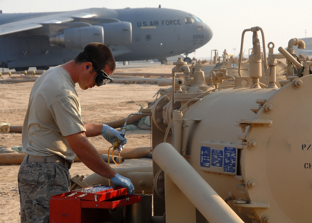 SOUTHWEST ASIA -- Staff Sgt. Michelangelo Serio, 386th Expeditionary Logistics Readiness Squadron Fuels Management Flight, takes fuel samples from a FORCE Fuel machine on Nov. 4 at an air base in Southwest Asia. Sergeant Serio is deployed from Aviano Air Base, Italy. (U.S. Air Force photo/Tech. Sgt. Raheem Moore)