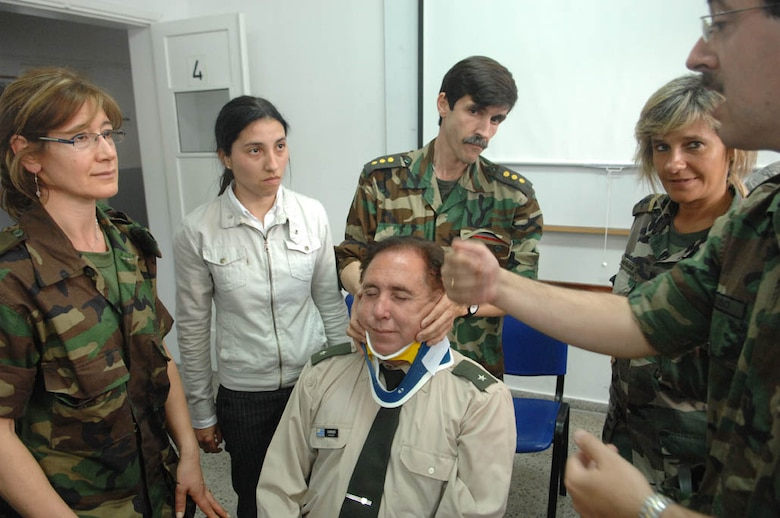 Uruguayan army medic 2nd Lt. Marco Pouso (right) discusses the proper application of a neck brace onto Colonel Felix E. Cardoza, an Uruguayan army engineer, during an exchange while participating Operation Southern Partner, Nov., 3, 2008. OSP is an in-depth, two-week subject matter exchange emphasizing partnership, cooperation and sharing of information with partner nation Air Forces in Latin America. 