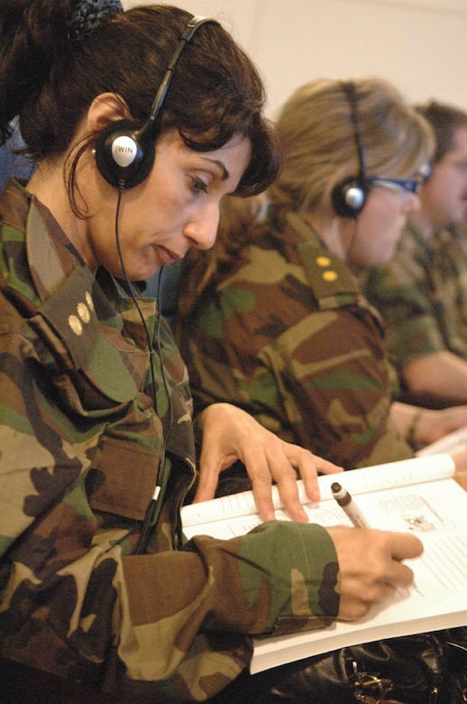 Uruguayan military nurses take notes while listening to the Spanish translation of a presentation given by members of the US Defense Institute for Medical Operation while participating in an exchange during Operation Southern Partner, Nov., 3, 2008. OSP is an in-depth, two-week subject matter exchange emphasizing partnership, cooperation and sharing of information with partner nation Air Forces in Latin America. 