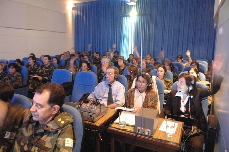 Audience participation was high during an exchange between US Air Force Medics from the Defense Institute for Medical Operation and military medics from Uruguay. A team of translators using wireless headphones for each participant allowed simultaneous translation of the presentations given by both U.S. and host nation medics allowing free flowing dialog during Operation Southern Partner, Nov., 3, 2008. OSP is an in-depth, two-week subject matter exchange emphasizing partnership, cooperation and sharing of information with partner nation Air Forces in Latin America. 