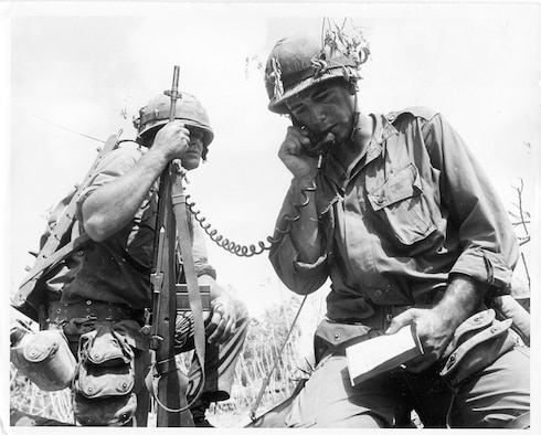 Private First Class Larry Smith, left, with his platoon leader, Lt. Ward, calling in an artillery fire. Private Smith became a war-seasoned military man on only his second day in Vietnam. When an ambush turned a routine patrol into a blaze of bullets and explosions, the young Marine looked to the platoon sergeant who had promised to guide him, only to see him killed.  Private Smith would survive the war with two Purple Hearts, even though medical personnel frantically working on him after a mine explosion pronounced he would die from his wounds.