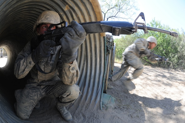 A basic trainee provides defensive cover during the tactical assault course Oct. 29 at Lackland Air Force Base, Texas. The tactical assault course tests their defensive tactics and communication skills. (U.S. Air Force photo/Staff Sgt. Desiree N. Palacios)