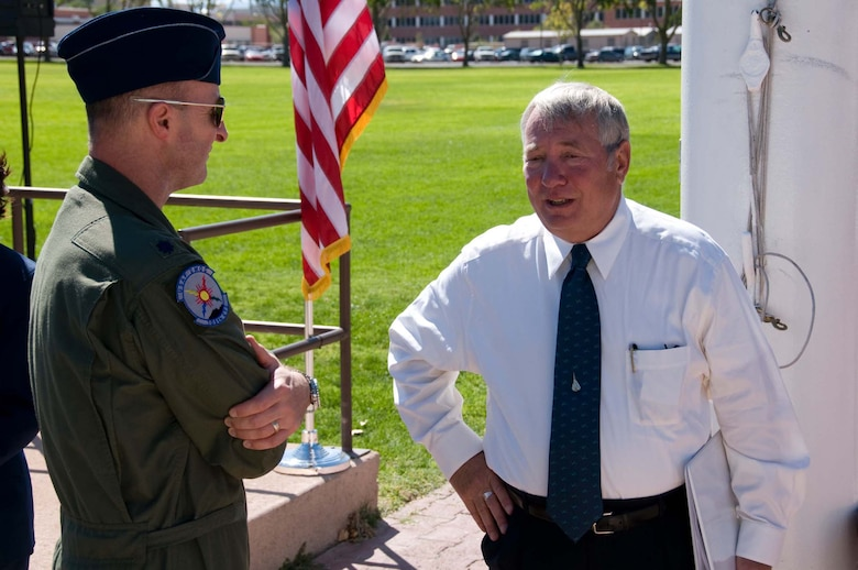 Col. Robert Hudson, right, speaks with an Air Force Operational Test and Evaluation Center member following his speech at the September 2008 opening ceremony for the annual POW/MIA 24-hour run at Kirtland AFB, N.M.