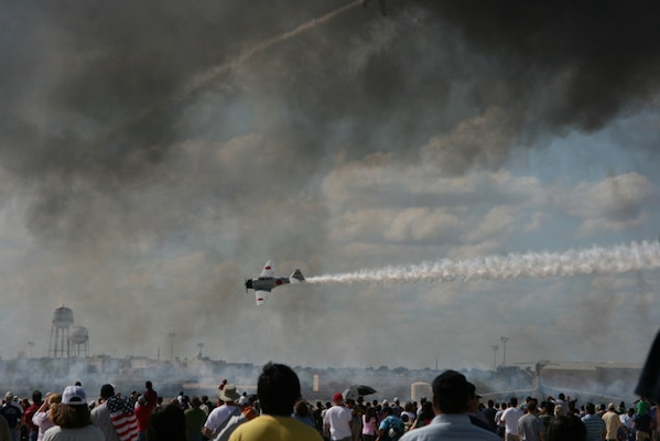 11/2/2008 - The crowd looks on as Tora! Tora! Tora! reenacts the bombing of Pearl Harbor during AirFest 2008 at Lackland Air Force Base, Texas. (USAF photo by Penny Lindley)