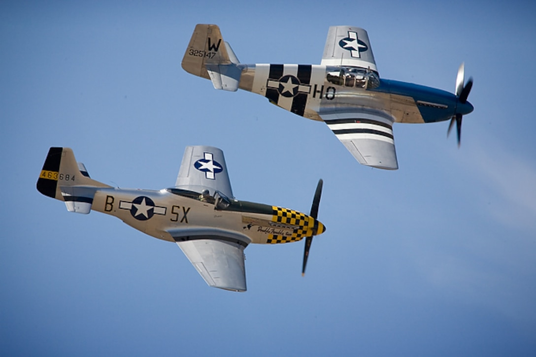 Two P-51 Mustangs make a pass over AirFest 2008 at Lackland Air Force Base's Kelly Field Annex, Texas on Oct. 31, 2008. This image is copyrighted and is the property of Lance Cheung and is available only to members of the armed forces and military organizations. (Courtesy photo/Lance Cheung)