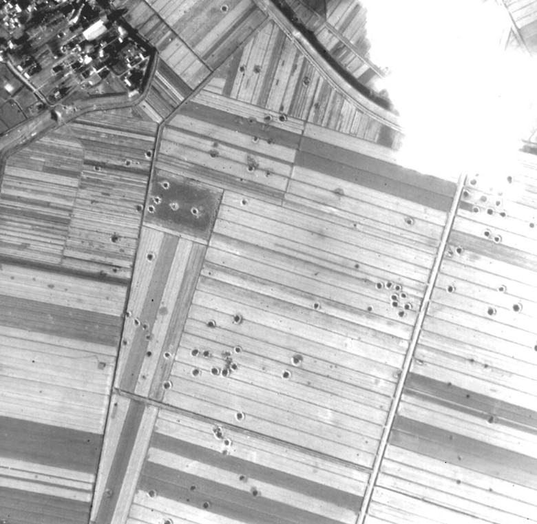 A World War II aerial photograph taken after a bombing mission of Germany shows craters created by bombs exploding and smaller holes resulting from bombs that did not explode on impact. Photos like this from the Air Force Historical Research Agency are key in determining whether an area in Germany is safe for commercial development. (Courtesy photo)