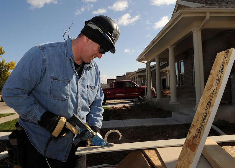 AURORA, Colo. -- Special Agent Robert Williams, of Detachment 801 from the Buckley Office of Special Investigations, helps construct a house while volunteering with others members of his detachment for Habitat for Humanity of Colorado, on Oct. 22. (U.S. Air Force photo by Senior Airman Steve Czyz)